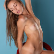 Nude girl on the chair — Stock Photo