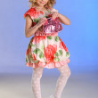 Lovely little girl posing in a beautiful dress — Stockfoto