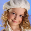 Portrait of little blonde girl in white beret — Photo #14101021
