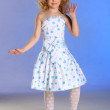 The lovely little girl posing in a white dress — Stock Photo