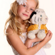 Cute girl posing with toy — Stock Photo #14101528