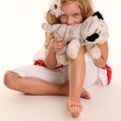 Cute girl posing with toy — Stock Photo