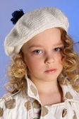 Portrait of little blonde girl in white beret — Stok fotoğraf