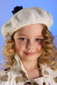 Portrait of little blonde girl in white beret — Stock Photo