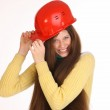 Charming girl in the construction helmet. — Stock Photo #47166299