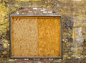 Old brick wall with boarded up window — Stock Photo