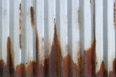 Corrugated rusting metal — Stock Photo