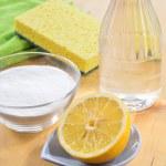 Natural cleaners. Vinegar, baking soda, salt and lemon. — Stock Photo #39182015