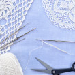 Crochet set. Crochet thread, doily, scissors and hooks. — Stock Photo