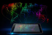 Neon outline map of the world from tablet — Zdjęcie stockowe