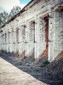 Old building - warehouse of white brick — Stockfoto