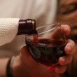 Man pouring red wine into the glass — Stock Photo