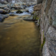 Stock Photo: Stone Wall Next to River