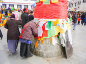 LHASA TIBET - FEB 24: Tibetan worshippers from all over Tibet pray in front of their holiest temple, the Jokhang February 24, 2009 in Lhasa, Tibet. — Stock Photo