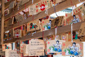 TOKYO, JAPAN - APRIL 4 2014: Ema praying tablets at Kanda Myojin Shrine. Ema are small wooden plaques used for wishes by shinto believers. — Stock Photo