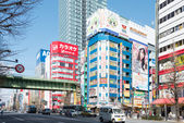 "TOKYO, JAPAN - APRIL 4 2014: Akihabara district. Akihabara is Tokyo's ""Electric Town"". This area is also known as the center of Japan's otaku (diehard fan) culture. — Foto de Stock"