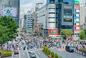 TOKYO, JAPAN - May 1 2014: Shibuya crossing is one of the most famed examples of a scramble crosswalk in the world. — Stock Photo