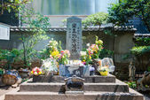 TOKYO, JAPAN - APRIL 23 2014: Masakado-zuka(Masakado's Tomb). Taira no Masakado (903?-940AD) was a descendant of Emperor Kanmu and a well-known hero of the eastern region of Japan. — Stock Photo