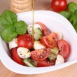 Tomato mozzarella salad with olive oil — Stock Photo
