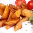 Baked potato wedges with tzatziki — Stock Photo