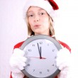 Young girl as Mrs. Santa with clock calls — Stock Photo