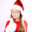 Blond girl as Mrs. Santa with a headset and okay — Stock Photo #14857879