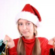 Contented girl as Mrs. Santa with shopping bags — Stock Photo
