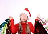 Träumen mädchen als mrs. santa mit einkaufstaschen — Stockfoto