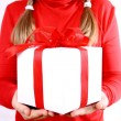 Girl holding a gift — Stock Photo