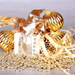 Golden Christmas decoration on silver background — Stock Photo