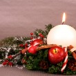Christmas wreath with candle and Christmas decoration — Stock Photo