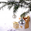Silver New Years ball with gifts over snow — Stock Photo