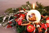 Christmas wreath with candle and angel — Stockfoto