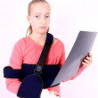 Stock Photo: Sorrowful girl with X-ray photo