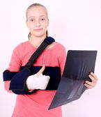 Contented girl with the X-ray photo and ok — Stock Photo