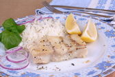 Steamed salmon piece with lemon and rice — Stock Photo