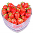 Heart shaped glass with red strawberries isolated — Stock Photo #17992161