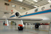Business aircraft in a aircraft hangar — Stock Photo