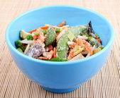 Frozen Asian vegetables in blue bowl — Stock Photo