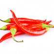 Royalty-Free Stock Photo: Five red hot chili pepper isolated
