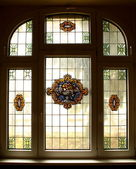 Big old window with beautiful colored murals — Stock Photo