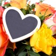 Stock Photo: Flower Bouquet with Heart plaque closeup
