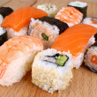 Maki sushi and Salmon Nigiri with cucumber — Stock Photo