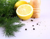 Lemon, dill and black pepper for fish marinade — Stock Photo