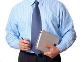 Businessman in blue shirt with appointment book and pen — Stock Photo