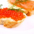 Caviar bread topped with keta salmon eggs - Stock Photo