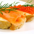 Snack with smoked salmon and keta eggs — Stock Photo