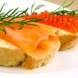 Snack with smoked salmon and keta eggs - Stock Photo