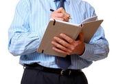 Ofis personeli notlar günlükte yazıyor — Stok fotoğraf
