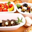 Mediterranean antipasto with vine leaves stuffed, ciabatta and garlic - Stock Photo